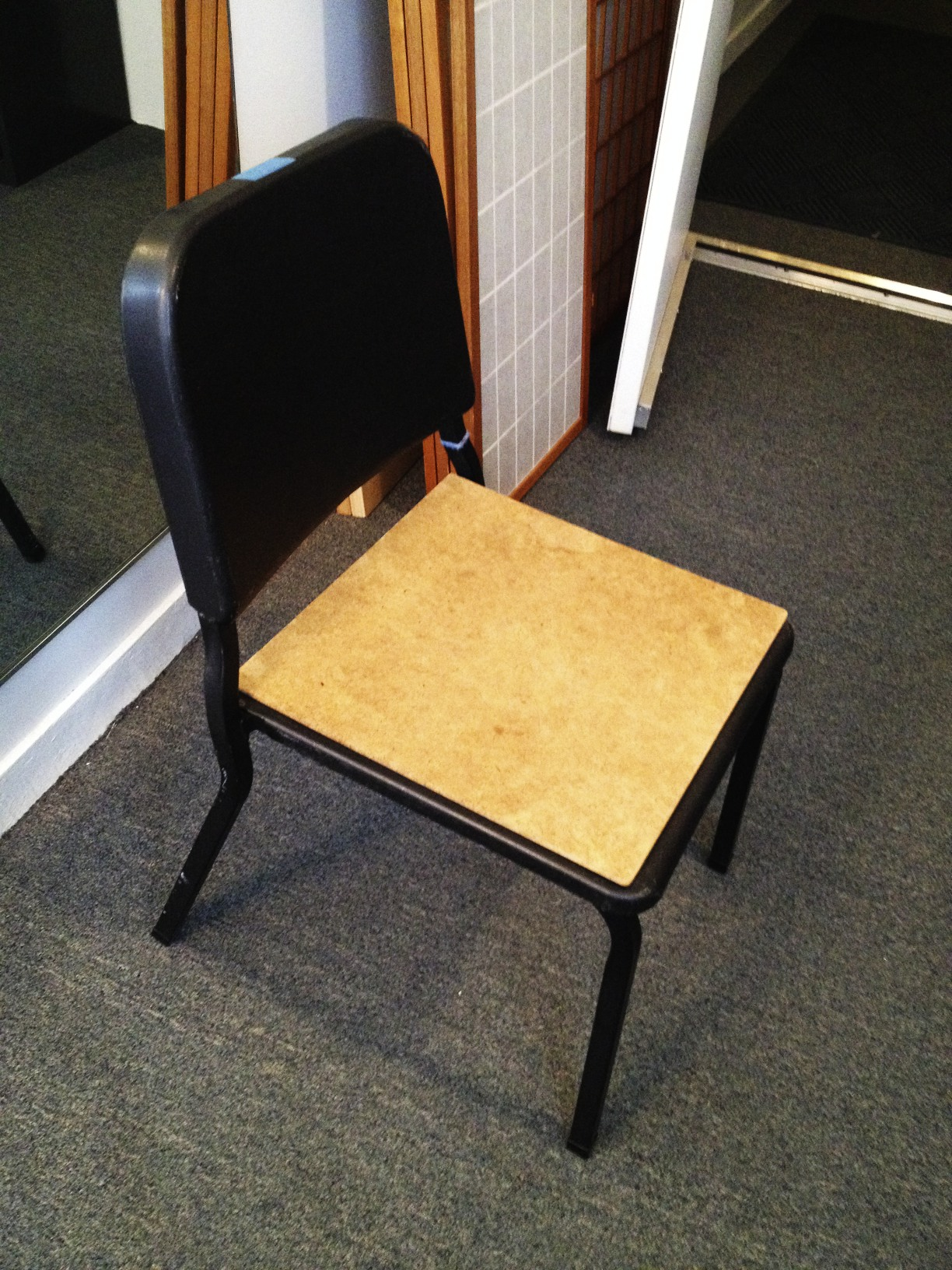 Blue tape on chair signifies that it is a short chair!