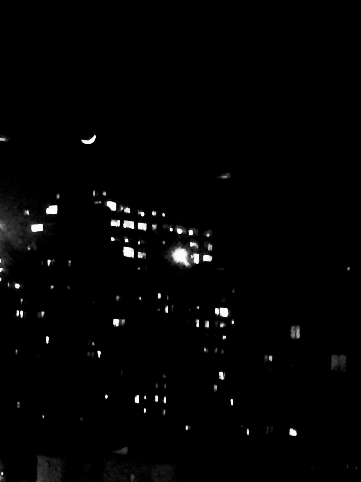 Looking out the window at TCAT-NYC...at the crescent moon...
